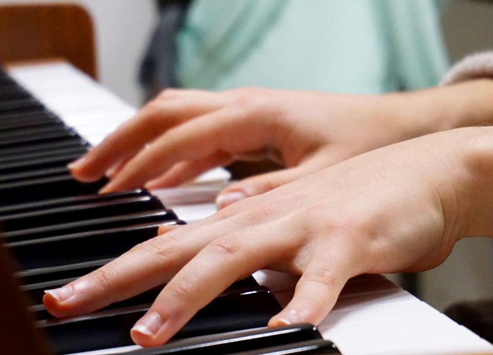 busy schedule, hands playing piano