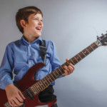 Guitar Lessons | Boy and Guitar