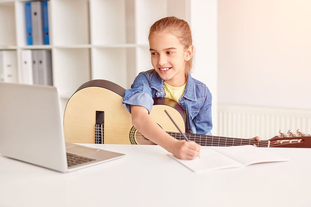 Virtual Music Lessons | Girl Learning Guitar on Computer